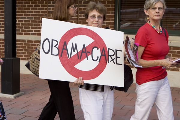 "The ""ladies"" are holding LaRuche ""Obama is a Nazi"" literature"