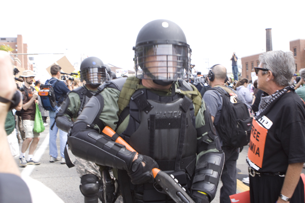 militarized riot gear - including shotgun - at Thomas Merton Center peaceful rally & march (9/25/09)