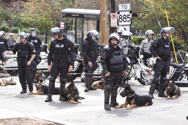 canine unit troops and motorcycle cops intimidate peaceful protestors