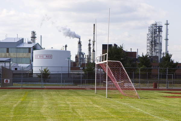 Paulsboro High School - Valero refinery and chemical plant in background. Note direction of plume from stack - pollution is being blown directly toward schoo. I could strongly smell volatile organci chemicals. After just 15 minutes shooting these pictures, I was nauseasous and had a headache and dry scratchy throat, pl
