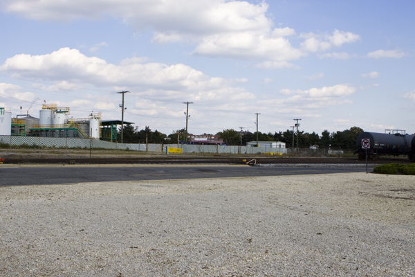 Paulsboro HS can be seen in background. Rail cars store extraordianrily toxic chemciclas neaby. AIr Products plant on left. Note plume of emissions from stack on far left. The wind is blowing right towards high school.