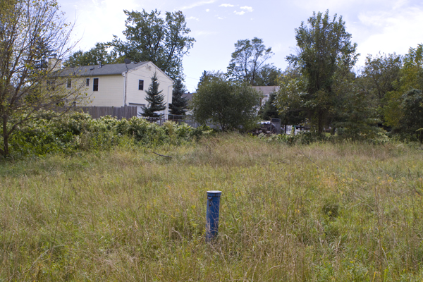 groundwater pollution monitoring wells at perimeter of landfill almost in backyards of surrounding homes.