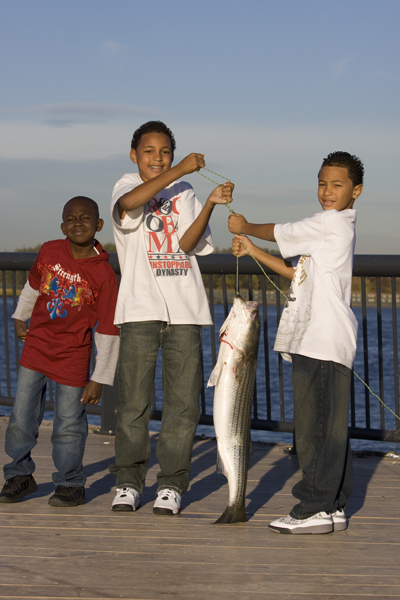 kids enjot excitement of a big fish