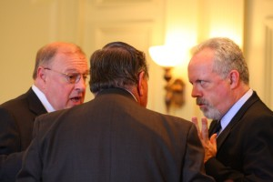 DEP Hazen (R) confers with Senators Smith (L) and Bucco (back facing) before Senate Environment Committee hearing (5/19/08)