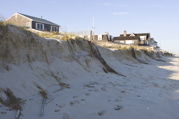 beach and dunes severely eroded behind homes in Normandy Beach